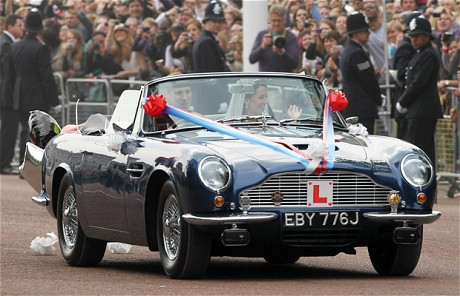 Kate catherine middleton and prince william leave in an aston martin 3